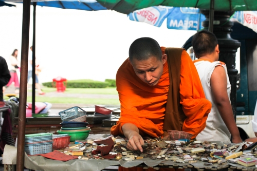 greedy monk with a toothbrush