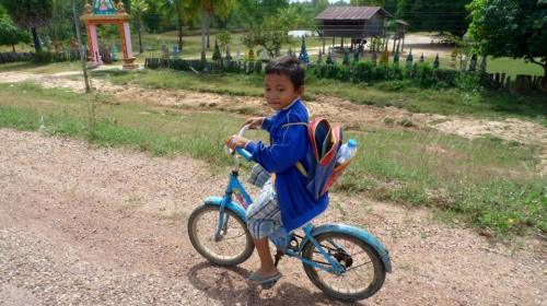 An even smaller Laotian on a bike