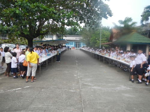 2 LONG rows of tables in front of the main building